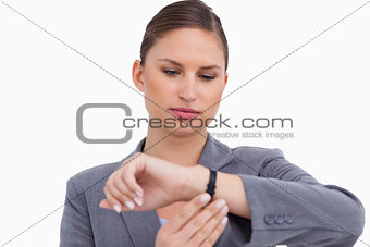 Businesswoman checking her watch