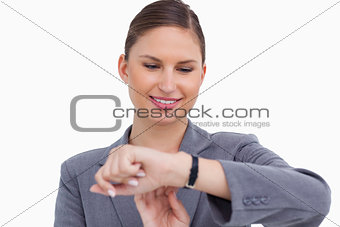 Smiling businesswoman checking her watch