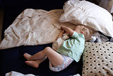 A child asleep  on the floor