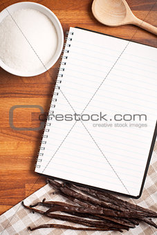 blank recipe book and vanilla pods