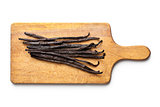 vanilla pods on chopping board 