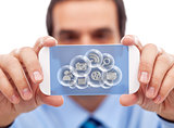 Businessman with smart gadget accessing cloud applications