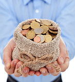 Man hands holding money bag with euro coins