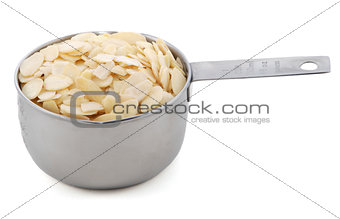 Flaked almonds presented in an American metal cup measure