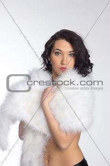 Beautiful girl in a fur shawl