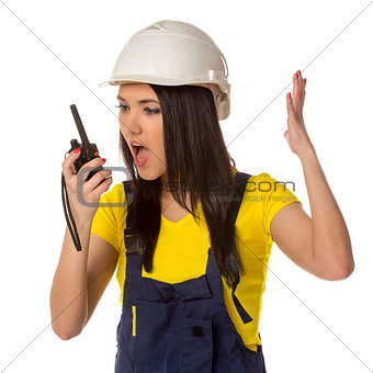 Angry worker looking to walkie-talky