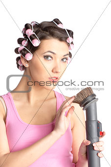 Funny girl with hair curlers on her head