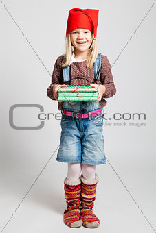 Smiling girl holding Christmas presents