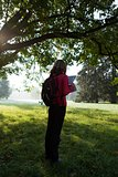Woman backpacker read the map among the morning nature