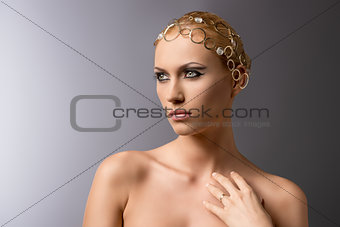 beauty portrait of blonde girl looks at right