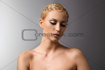 beauty portrait of blonde girl looks down
