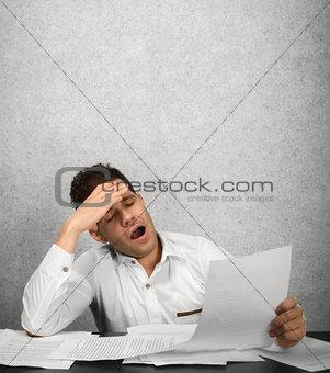Tired businessman working