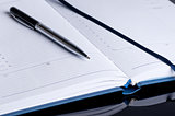 Notebook and pen in composition close up
