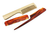 Wooden and plastic combs over white