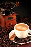 cup of coffee and coffee mill