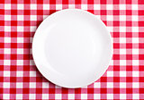 Plate on a tablecloth