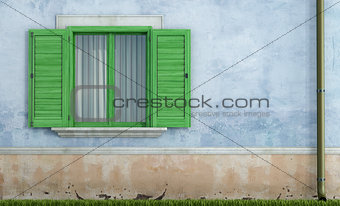 Old house with green wooden windows