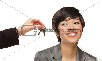 Mixed Race Young Woman Being Handed Keys on White