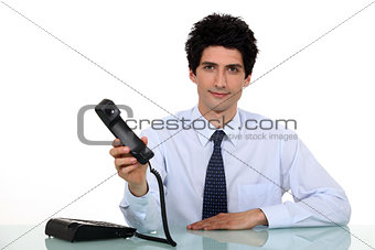 Businessman offering telephone