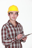 Man in a hardhat with a clipboard