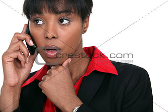 beautiful black woman making a call isolated on white