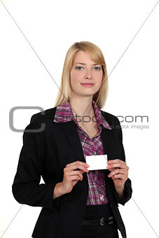 A businesswoman presenting her card.