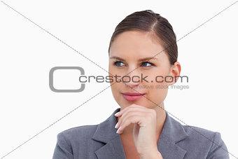 Close up of thinking tradeswoman