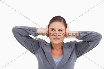 Close up of tradeswoman covering her ears