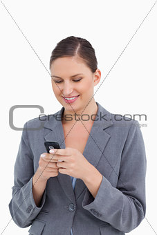 Close up of smiling tradeswoman reading text message