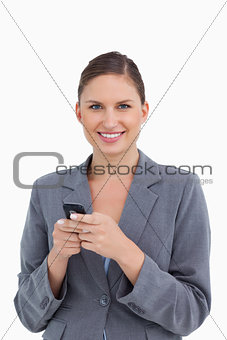 Close up of smiling tradeswoman holding cellphone