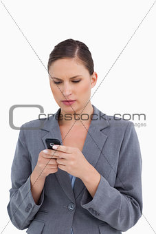 Close up of tradeswoman reading text message