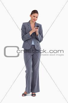 Tradeswoman writing text message