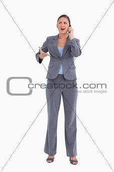 Angry tradeswoman yelling at caller