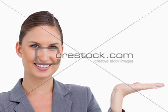 Close up of smiling tradeswoman holding her palm up