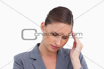 Close up of tradeswoman having a headache