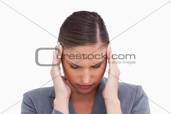 Close up of tradeswoman experiencing a headache