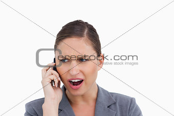 Close up of angry tradeswoman yelling at caller