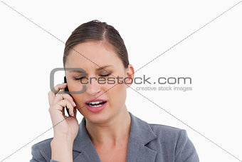 Close up of angry tradeswoman shouting at caller