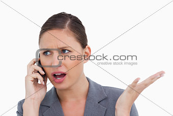 Close up of irritated tradeswoman on her cellphone