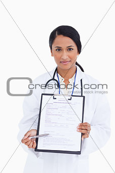 Close up of female physician pointing at form
