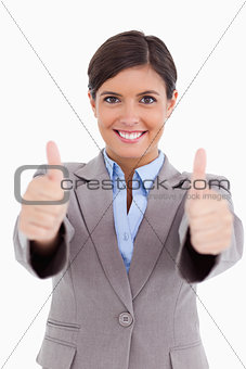 Close up of female entrepreneur giving thumbs up