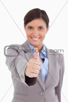 Close up of thumb up being given by female entrepreneur