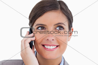 Close up of smiling female entrepreneur on her cellphone