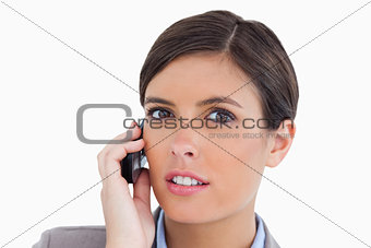 Close up of female entrepreneur talking on her cellphone
