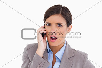 Close up of angry female entrepreneur on her cellphone
