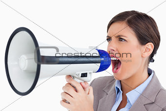 Close up of female entrepreneur yelling through megaphone