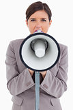 Close up of female entrepreneur shouting through megaphone