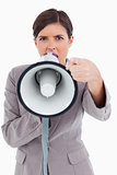 Close up of angry yelling entrepreneur with megaphone
