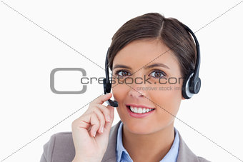 Close up of smiling female call center agent adjusting her heads
