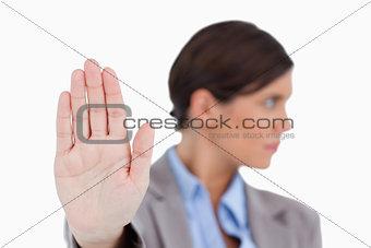 Close up of female entrepreneurs hand signalizing stop